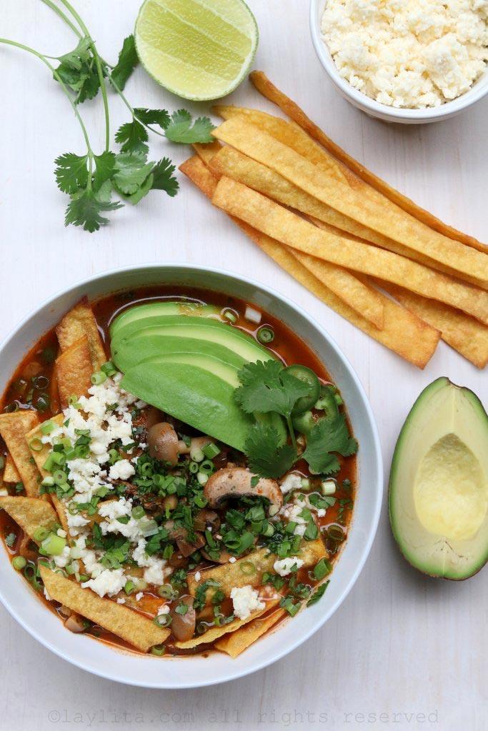 Mushroom tortilla soup with avocado