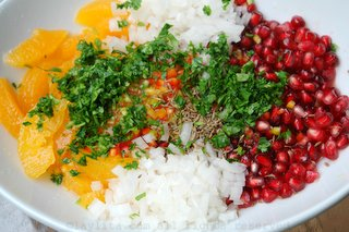 Combine the ingredients for the spicy orange pomegranate salsa in a bowl