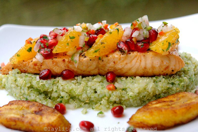 Grilled fish topped with pomegranate orange salsa