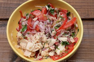 You can mix the tuna fish with the marinated onions and tomato salsa ahead of time or right before serving.