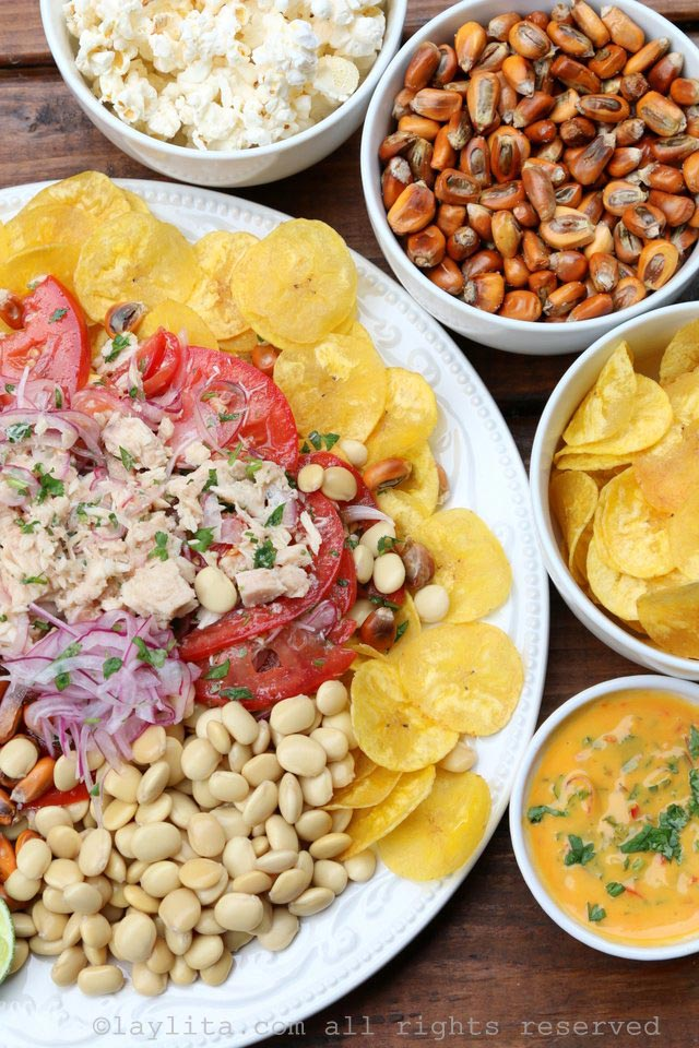 Tuna ceviche with sides of plantain chips, tostado or chulpi corn nuts, lupini beans, and tamarillo hot sauce
