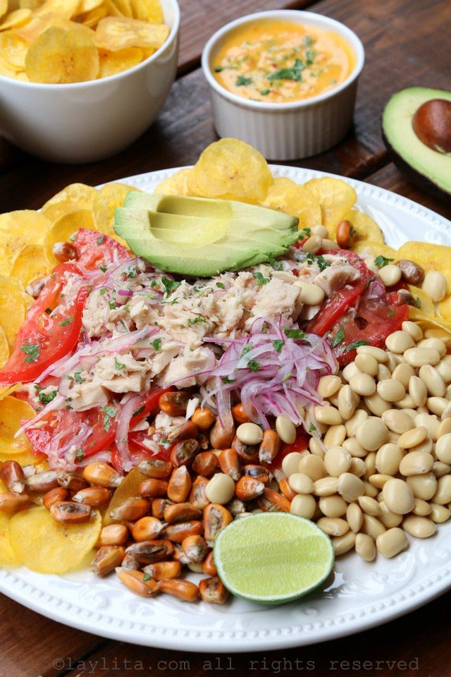 Tuna fish ceviche with avocado, plantain chips, lupini beans, toasted corn, and hot sauce