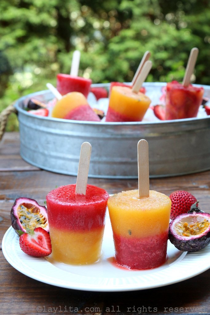 Layered fruit paletas with strawberry and passion fruit