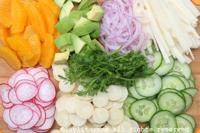 Hearts of a palm, avocado, jicama, radishes, cucumber, oranges, cilantro, onions for salad