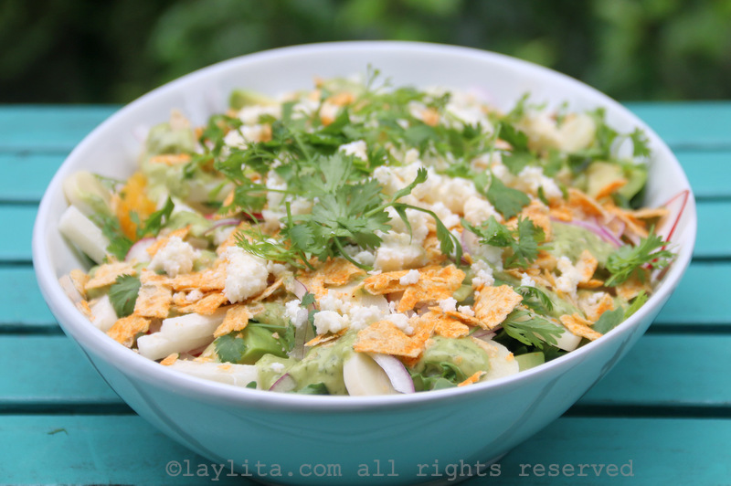 Add the tortilla chips and crumbled queso fresco