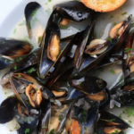 Mussels in white wine sauce with herbs and garlic
