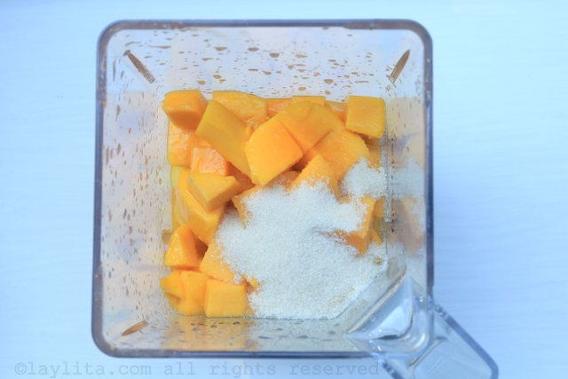 Blend the pineapple, mango, passion fruit juice, lime juice, and sugar