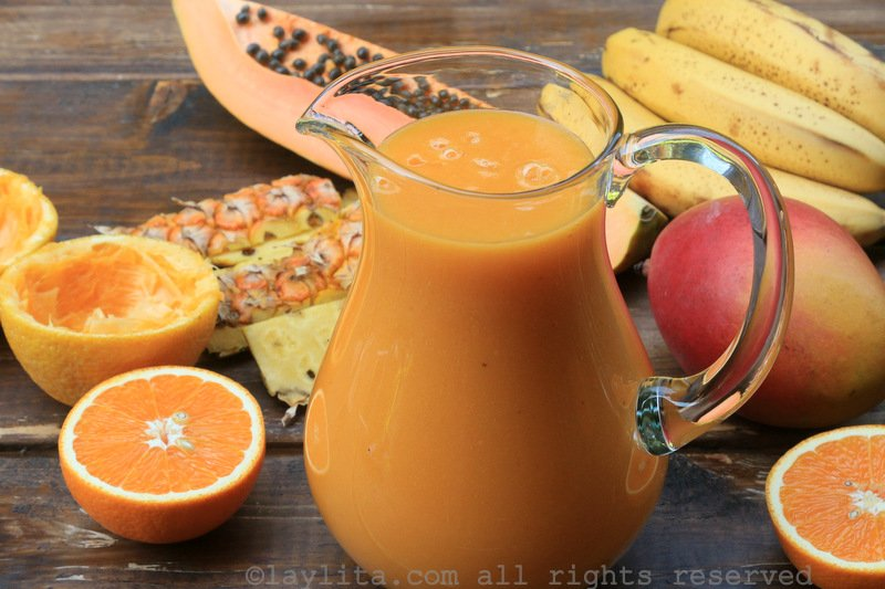 Tropical fruit smoothie with papaya pineapple banana mango and orange