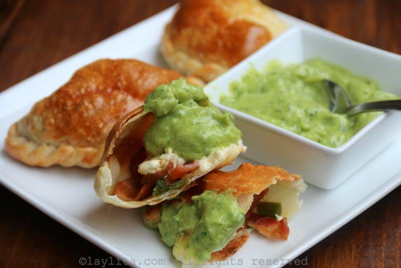 Jalapeño popper empanadas with avocado sauce