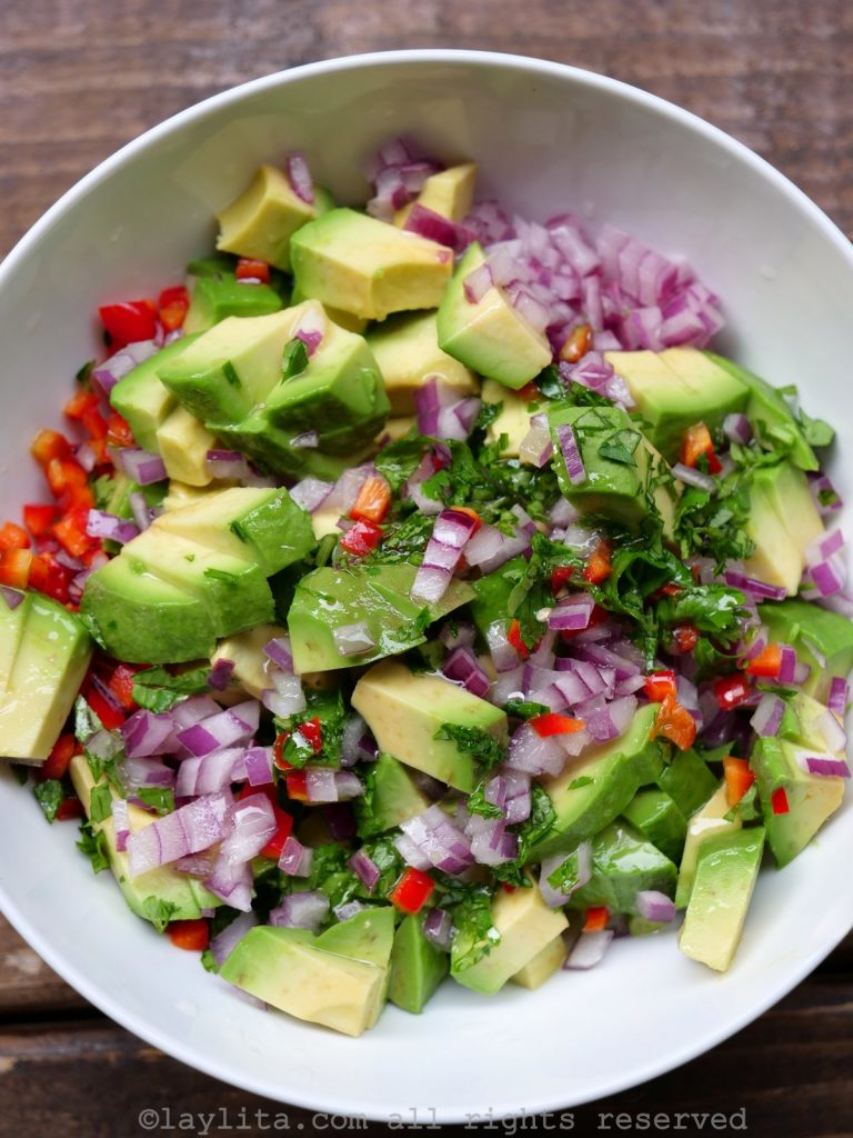 Avocado salsa with onion, cilantro, and lime juice