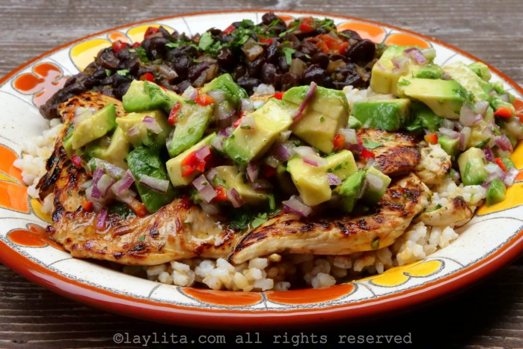 Pollo a la plancha with avocado salad, rice, and beans