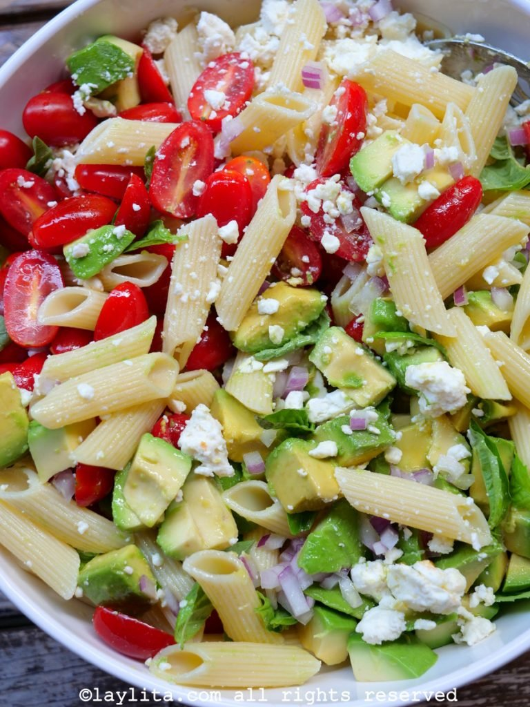 Avocado pasta salad with tomatoes and feta cheese