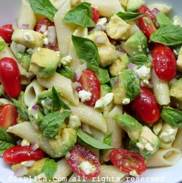 Avocado pasta salad with tomatos and cheese