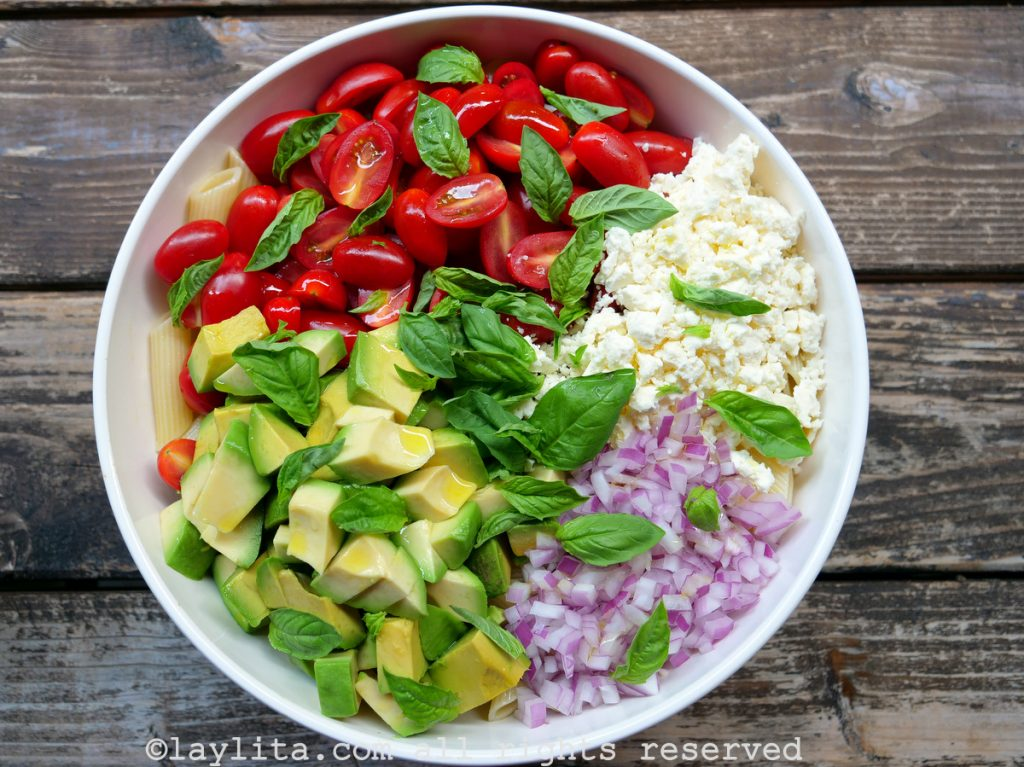 Pasta salad with avocado, tomatoes and cheese