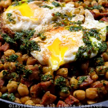 Chickpeas with chorizo and chimichurri, served with fried eggs