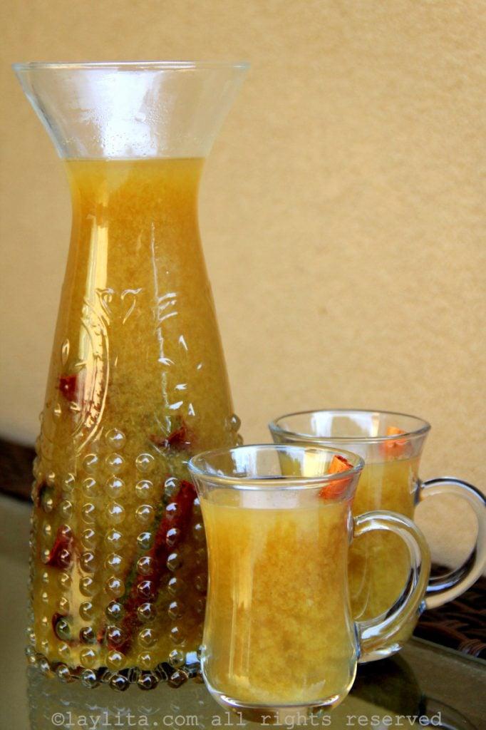 Ecuadorian naranjillazo or canelazo drink with naranjilla fruit