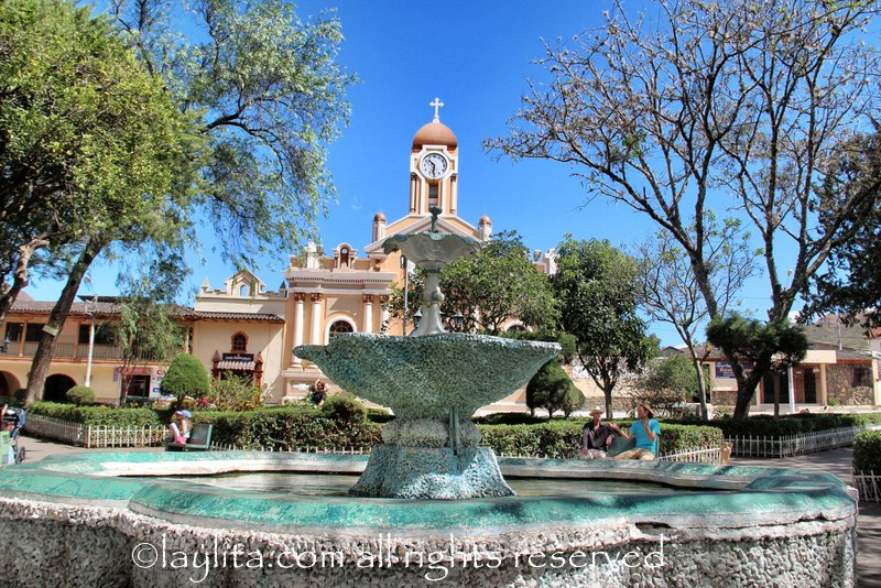 Fountain and church in Vilcabamba, Ecuador