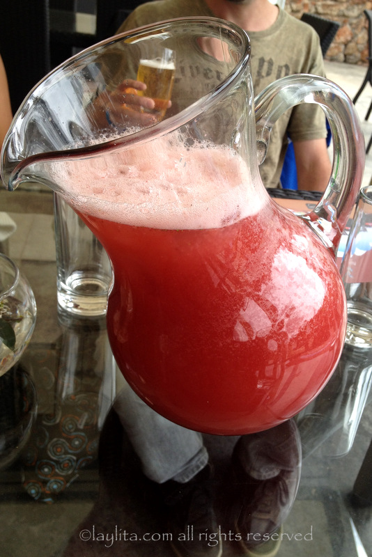 Strawberry juice in a cool slanted pitcher