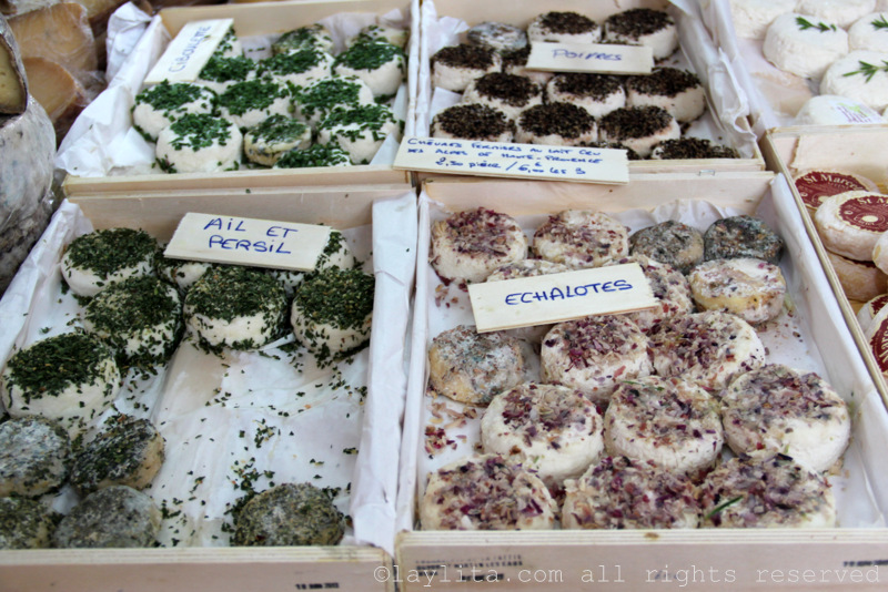Selection of goat cheeses at the market