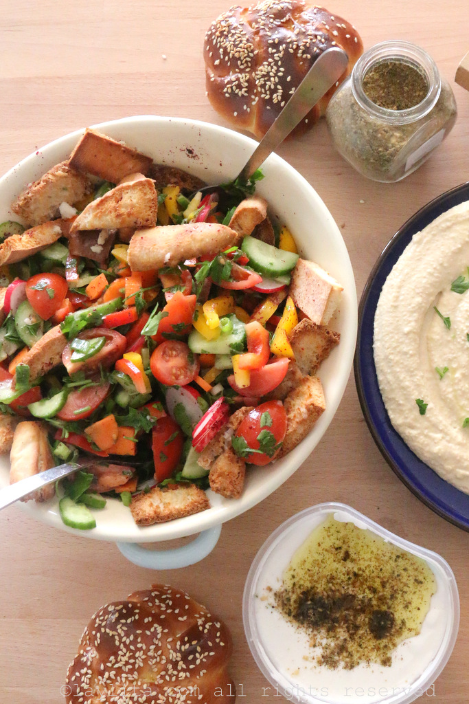 Fatush salad, hummus, and challah bread with local food bloggers