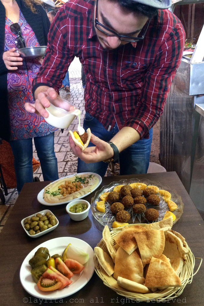 Tasting falafel at the Akko market with Osama Dalal