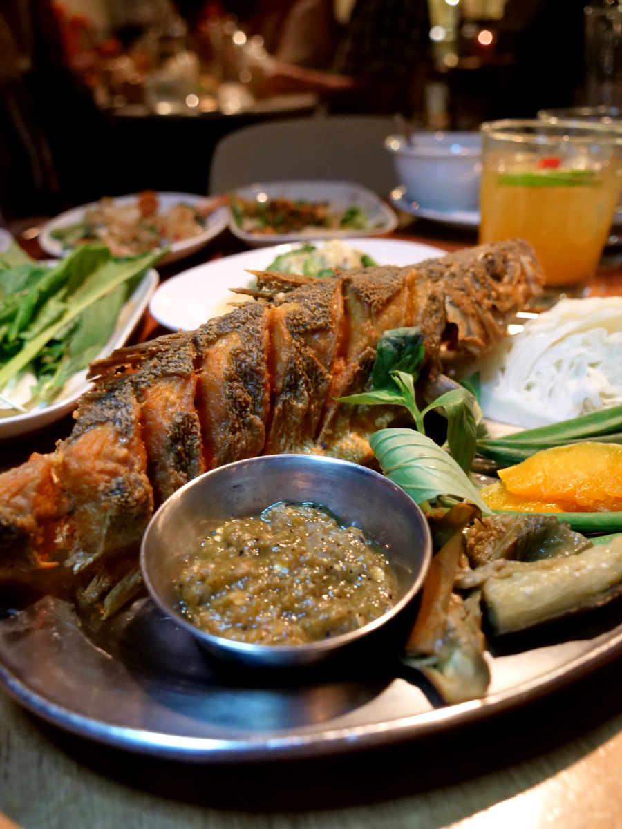 Deep fried sea bass with a grilled green chili dip