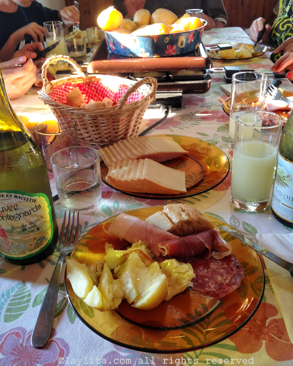 A family raclette meal in the Alps