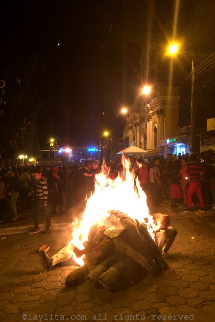 Burning the Año Viejo effigies in the street in Ecuador