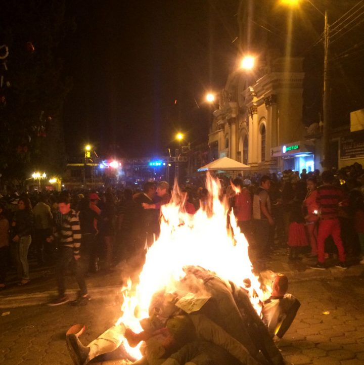Burning the Año Viejo effigies in the street in Ecuador